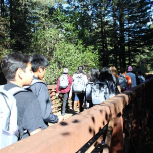 Picture of students crossing a bridge